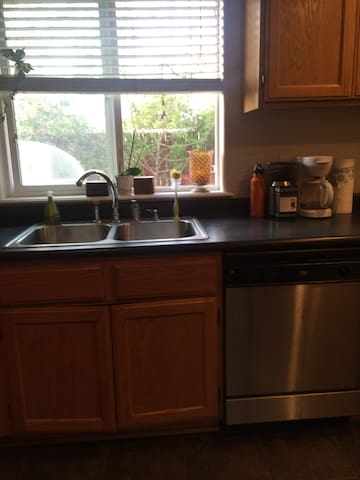 Deep stainless steel sinks and dishwasher. Coffee? Yes!