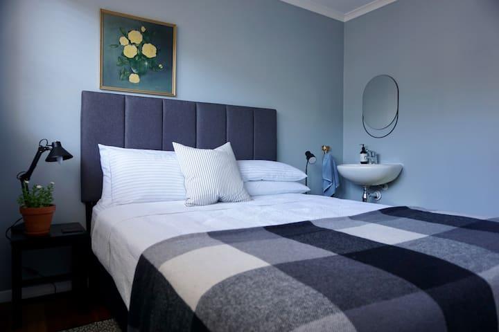 Queen bed. Wardrobe.