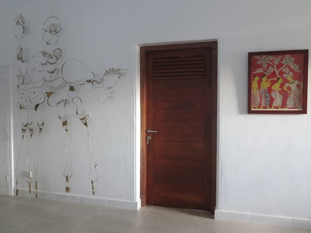 Sculpture wall with entrance door to room