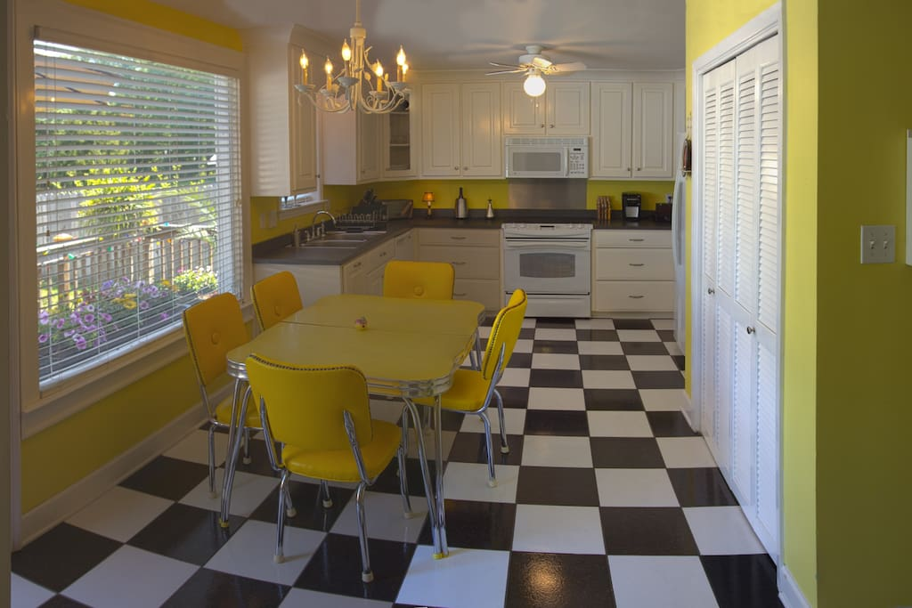 A neat, clean 50's-style kitchen with great backyard view.