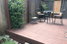 Backyard deck. Fun place to hang out. Edison lights for the evening.