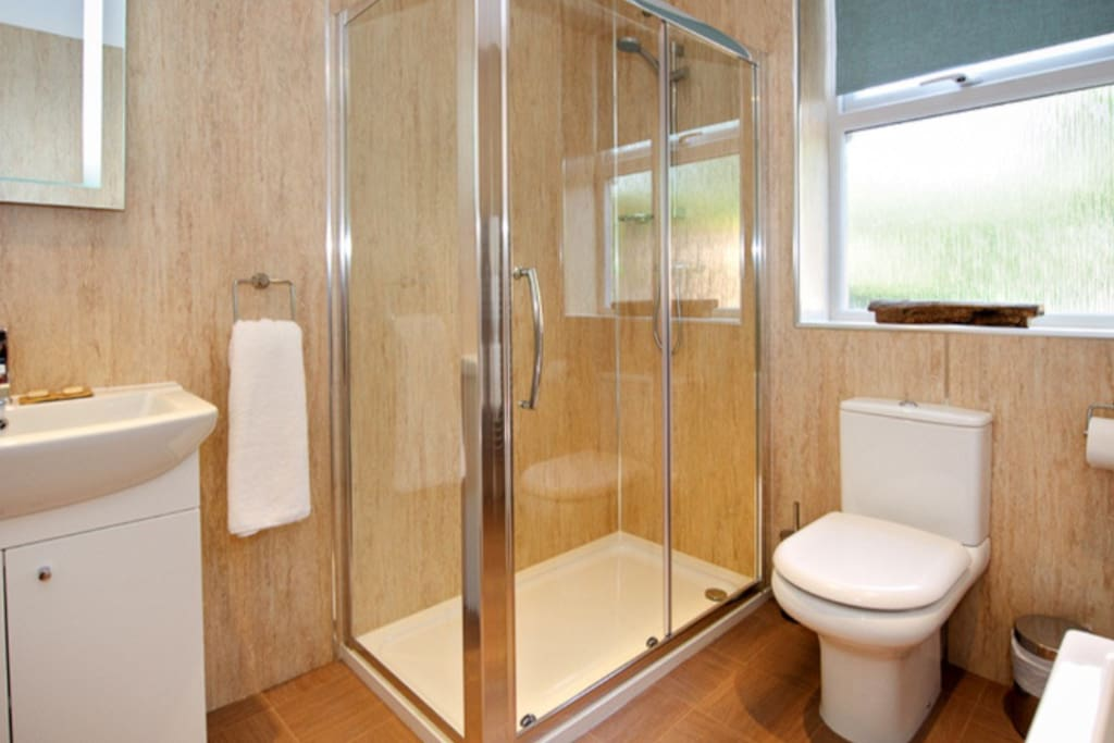 En suite bathroom with walk in shower & bath.