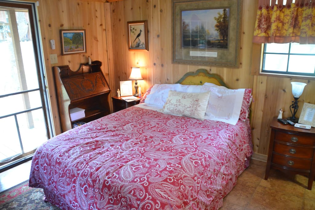 The cabin is decorated in a French Country Motif and features a comfortable queen bed loaded with pillows & a down feather duvet. There is a small desk, dressers, easy chair & small tv.
