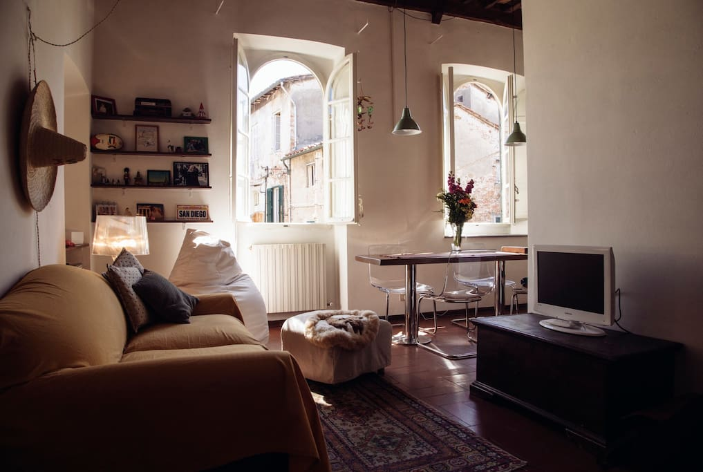 Lounge with high ceilings and large windows