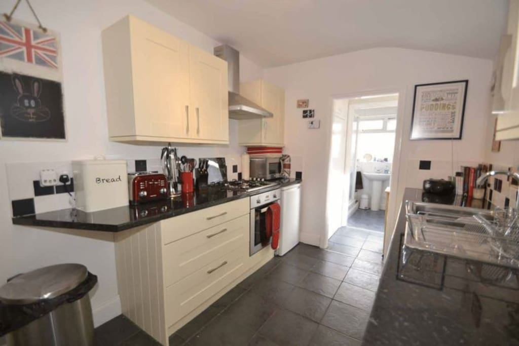 The lovely kitchen area, with an oven, fridge, freezer, 4 hotplates, microwave, toaster, kettle, washing machine. Shower room just in front.