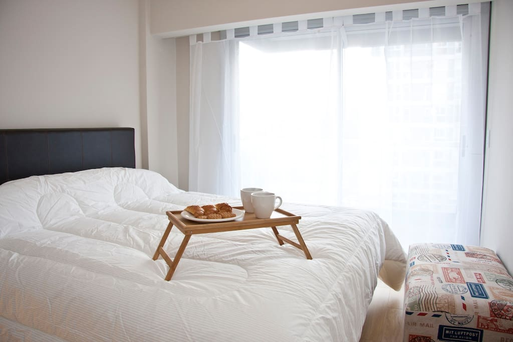The main bedroom has a king-sized bed and opens out onto the balcony
