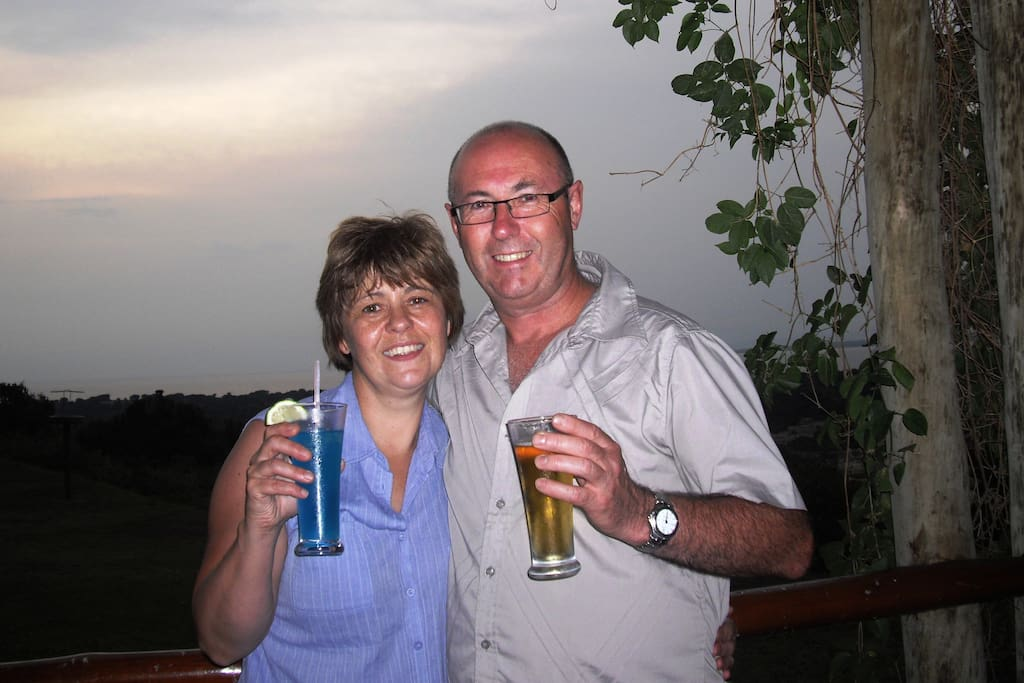 Your hosts Dave and Alison enjoying a sundowner on safari