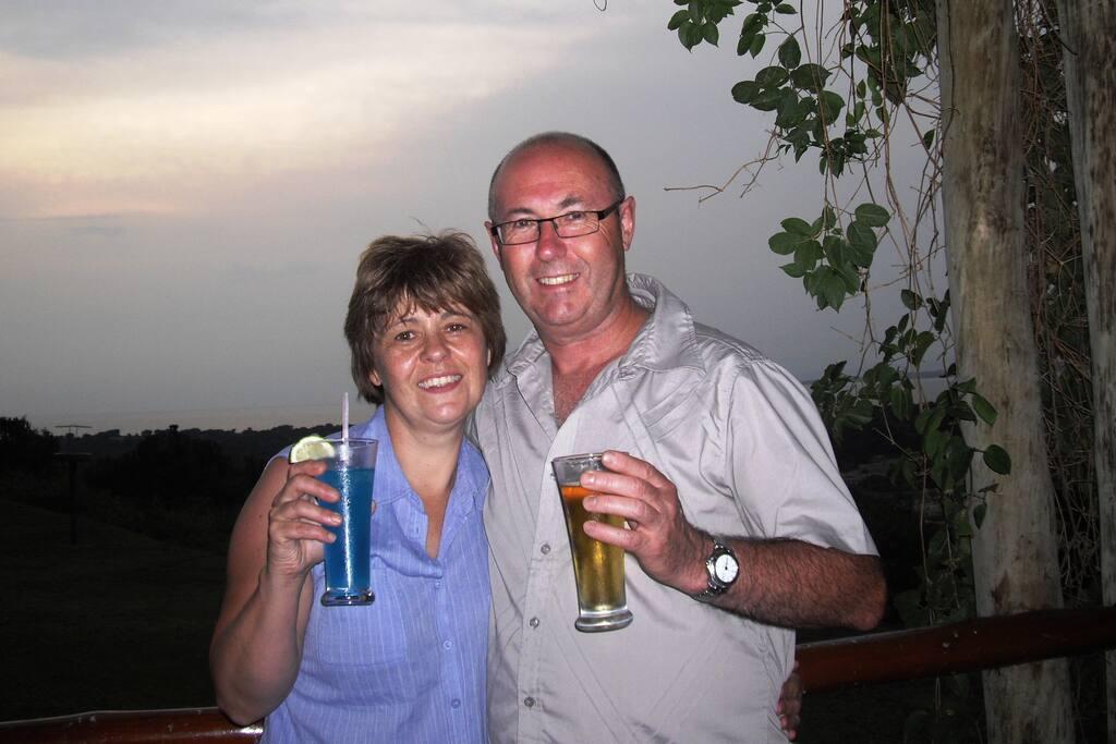 Your hosts Dave and Alison enjoying a sundowner on safari