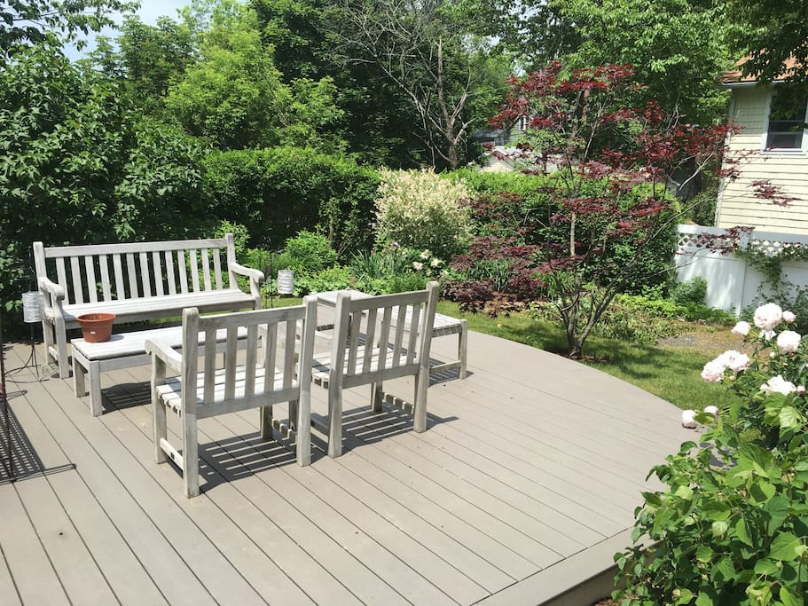 large outdoor deck surrounded by gardens