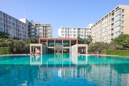 Giant pool condo with gym near a mall&bus terminal