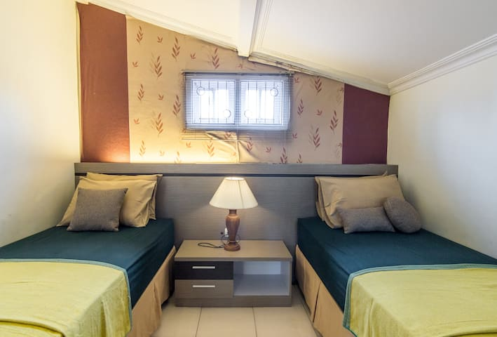 This room on second floor equipped by twin beds and an AC