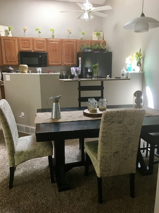 Dining room table and kitchen areas