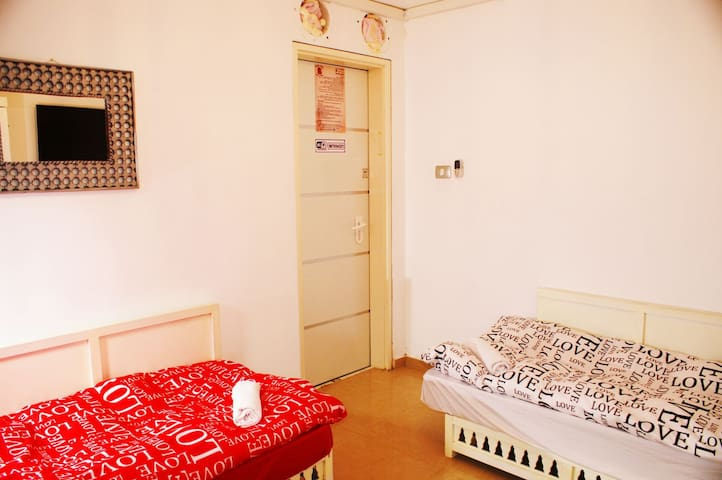 Two single beds with shared bathroom
