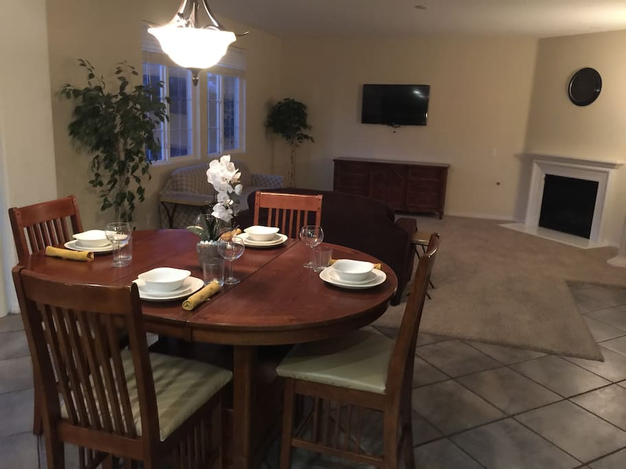 "Adjustable, high seating Casual Table for up to six (6) persons. Views of the Casual Living Room, Kitchen and Back Yard.  Relax in-front of a 47"" flat screen TV and warm gas fire place."