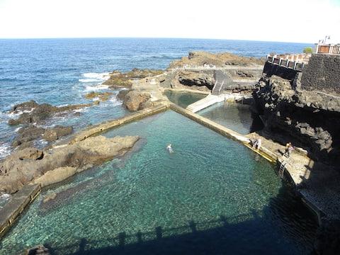 Byt přímo u přírodních bazénů