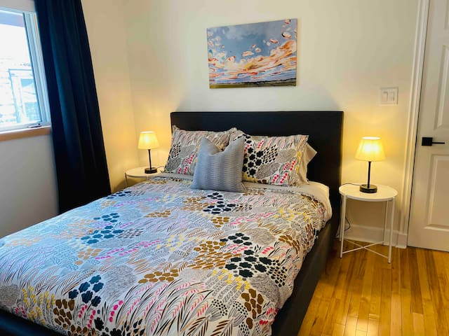 Master bedroom features a queen size Douglas mattress and comfortable bedding. Extra blankets are provided for your comfort. Also featured is a ceiling fan and blackout blinds and curtains.