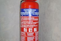 emergency lighting and fire extinguishers and smoke detectors for safety in the home