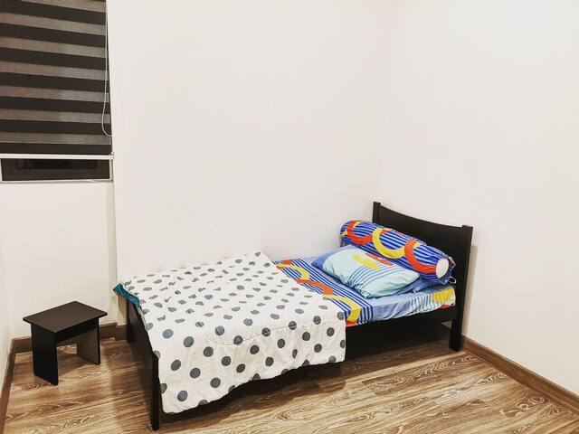 Your cozy single room for an unforgettable getaway in Kuala Lumpur!