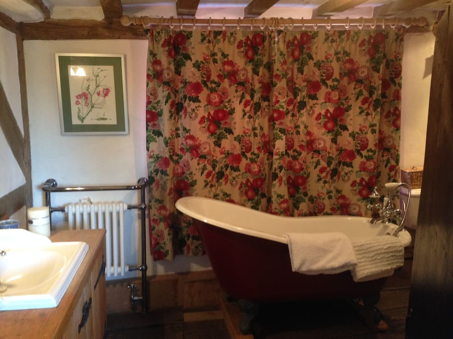 Victorian bath and a separate shower in a bathroom across the landing. This is for use for guests in the twin room only.
