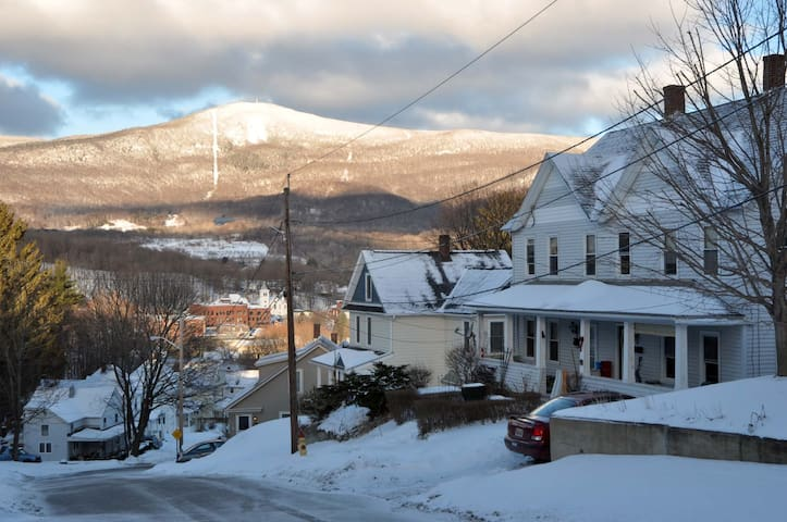The apartment is the left side of grey house in right of photo. Mt. Greylock is the highest point in Massachusetts.
