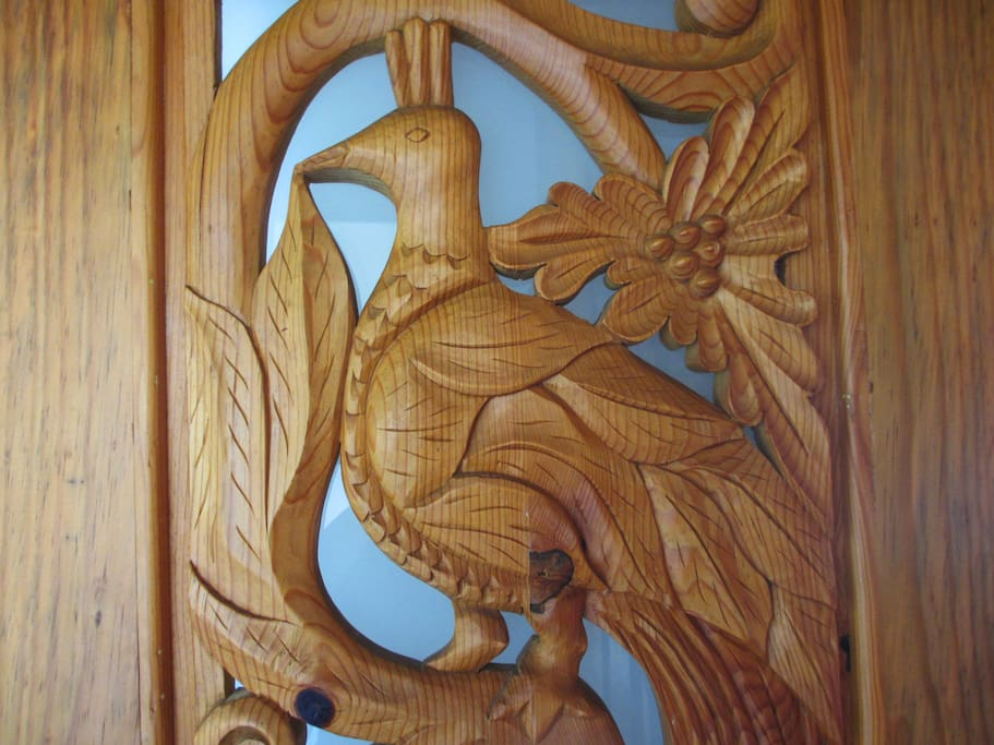 Bathroom door carved with motifs related to the room