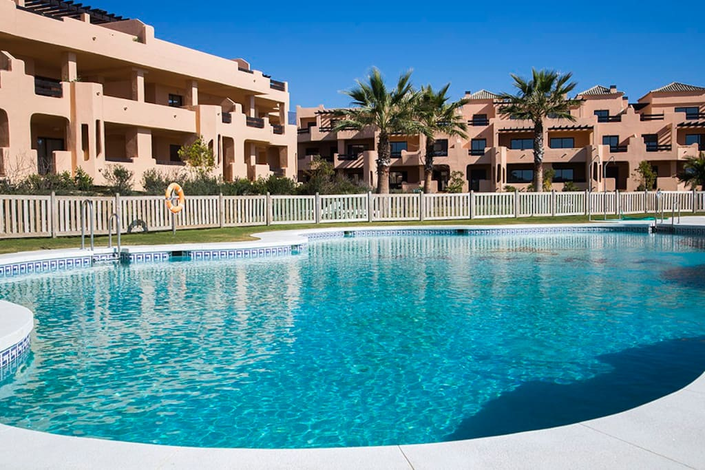 Relax in the 2 pools at Casares Beach Apartments