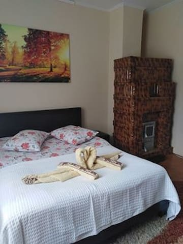 Double bedroom with wood burner stove