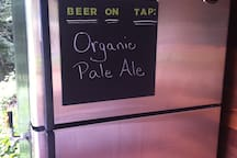 There is also a guest keg with local micro beer. It is on an honor system either by the glass or by the growler.