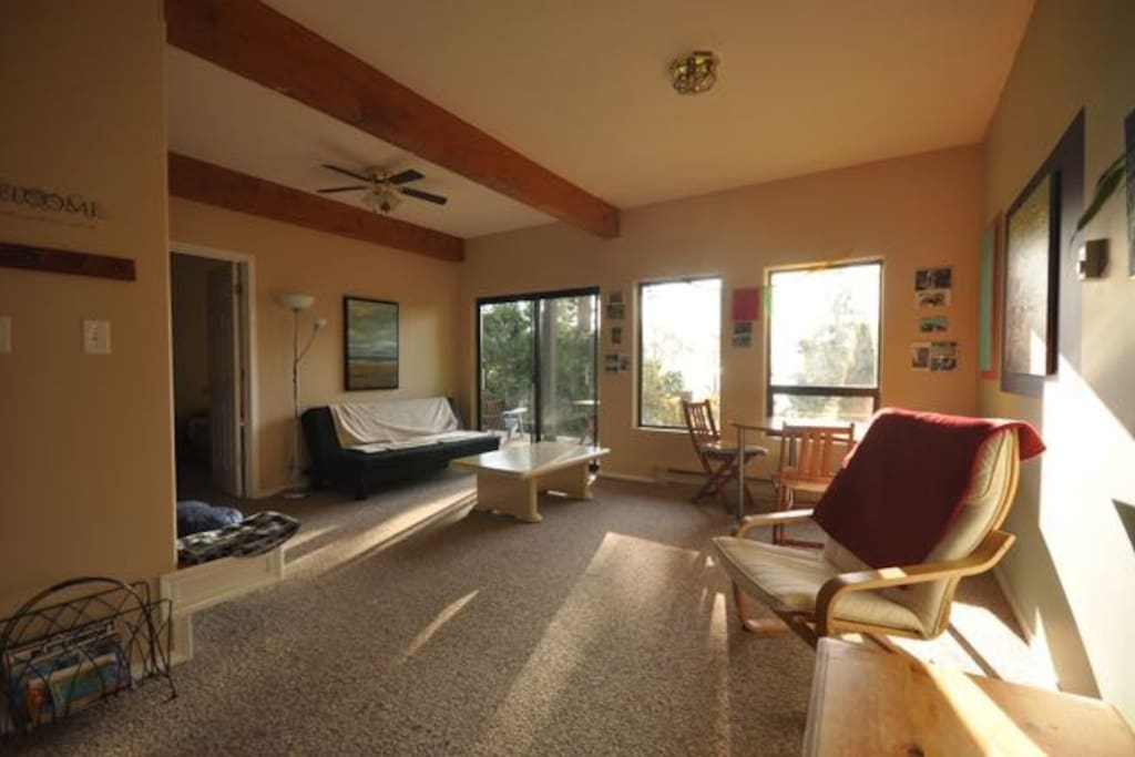 Living room with access to the patio and garden. Ocean View