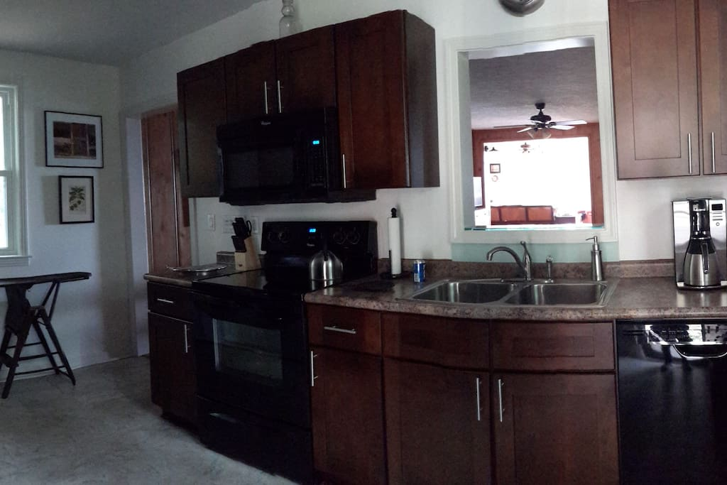 Kitchen with full size appliances. Also hold a full size front loading washer and dryer.