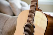 Inspirations awaits! This beautiful Breedlove solid top acoustic guitar hangs on the wall or cuddles with you on the couch.