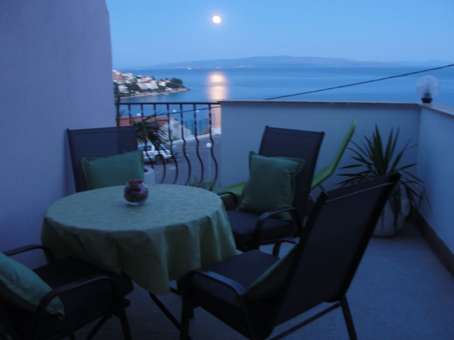 Terrace with a view to the sea and moon