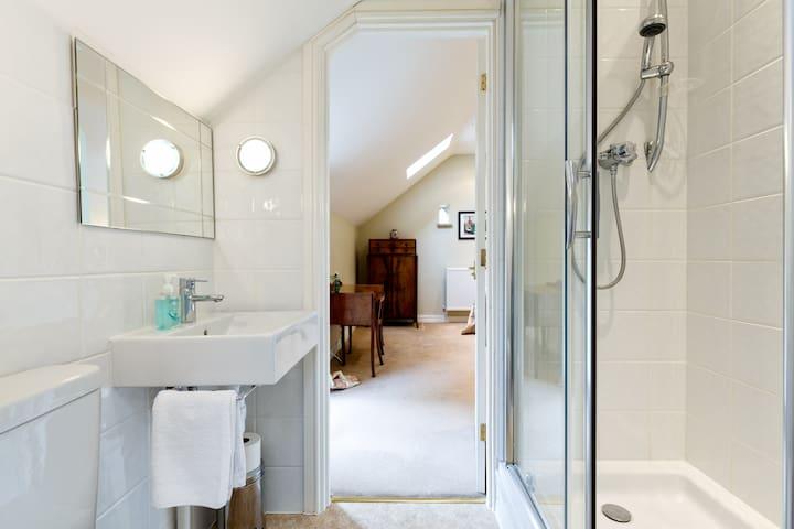 En-suite bathroom with large shower cubicle