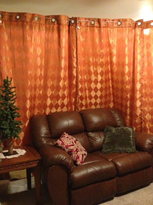 Wall to wall privacy curtains give the room a nice cozy feel.