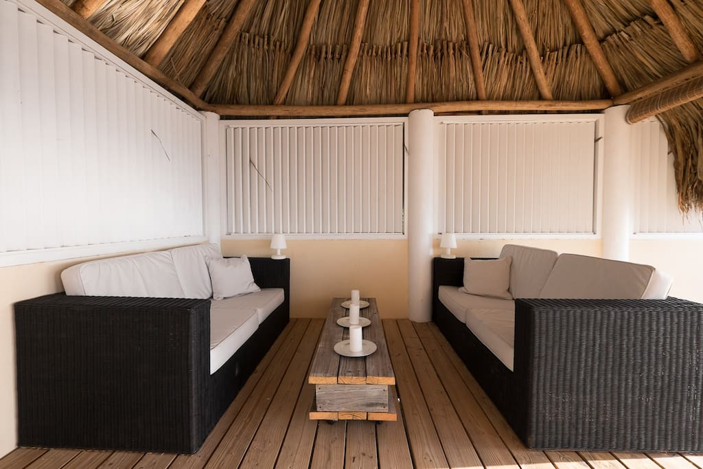 Cozy, cool and  shaded sitting area under the Palapa