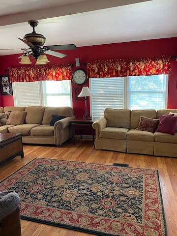 Living area with two sofas, one large sectional and and a three seat sofa hideaway bed