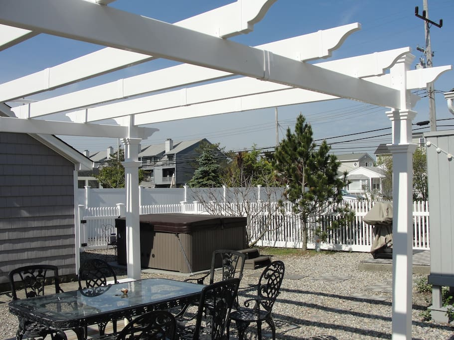 Spacious private outdoor patio with lots of seating and shade.  gas grill and outdoor shower