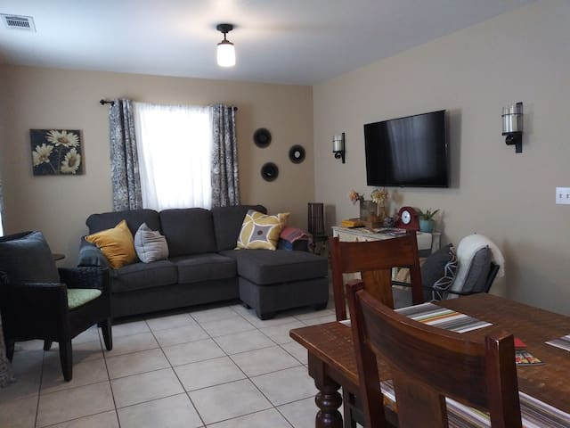 Very cozy living room with new couch and comfy chairs.  Smart TV and wifi