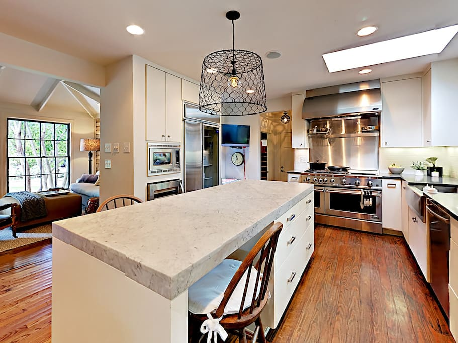 The kitchen center island with marble top offers ample prep space