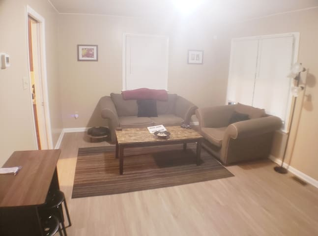 Eat-In Living Room with Pocket Door, Forced Air Heating and AC (thermostat on wall), Table/Stools (can also be used as workspace area)