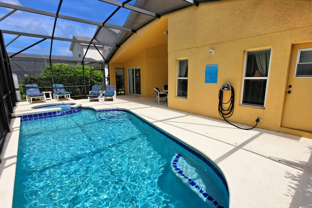 Welcome to your Florida vacation! This spacious deck and sparkling clear pool make the perfect place to kick back and relax under the sun.