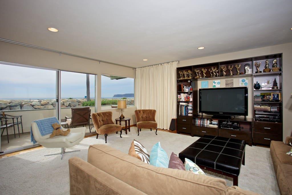 Living room, full view of ocean, flat screen TV, patio