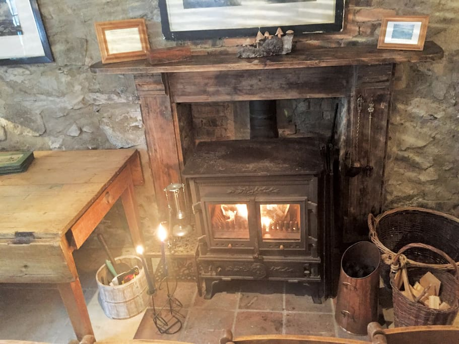 The cosy wodburner with complimentary coal and logs for winter guests on arrival