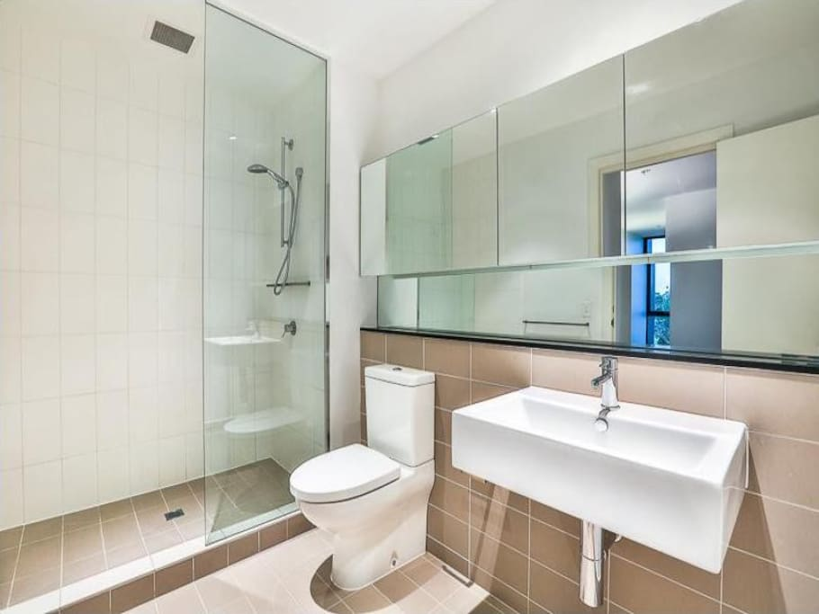 Modern private bathroom with big mirrors