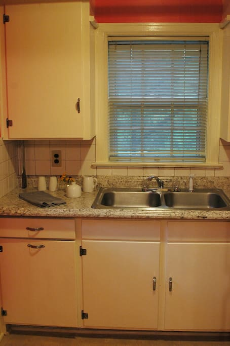 Kitchenette - includes stove, oven, microwave, refrigerator, coffee maker, pots/pans, utensils, dishes, coffee, sugar, some spices