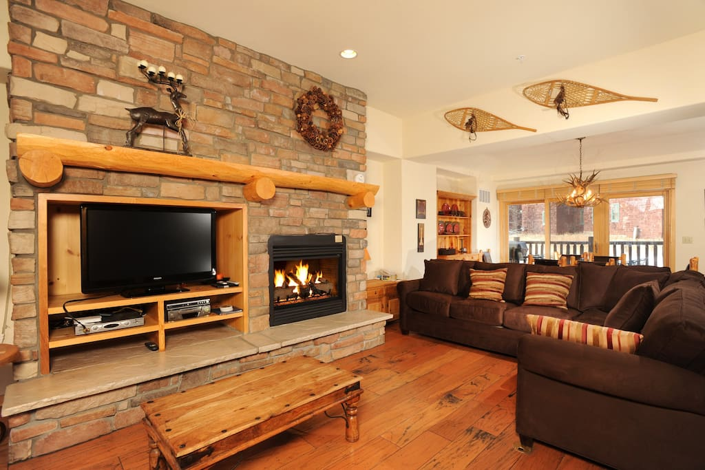 Warm up by the fireplace or entertain at the dining table.