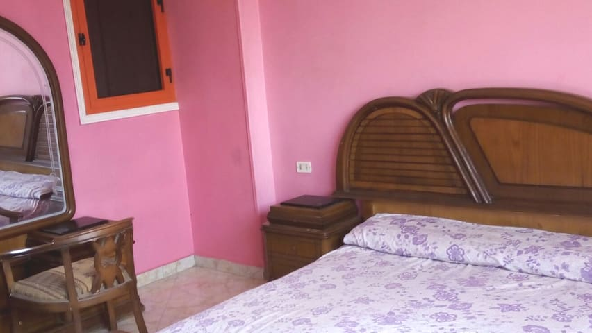 The master bedroom is spacious and bright all day long, with a large window to allow sunlight and fresh air to enter It has a cool air conditioner that works very efficiently It has a double bed with fine Egyptian cotton sheets It has a wardrobe for