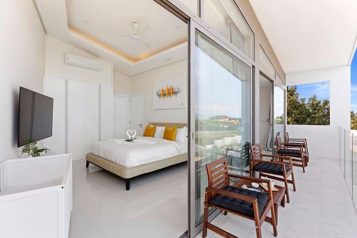 Bedroom 1 with sea view balcony