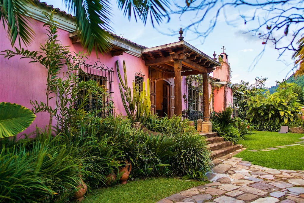 This traditional stand alone home is surrounded by gardens and has a volcano view.