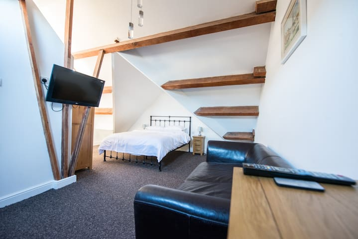 This attic suite has a king size bed, its own shower room with toilet, TV and leather sofa which can double as a full size double bed. An Ideal retreat after a day out with the family.